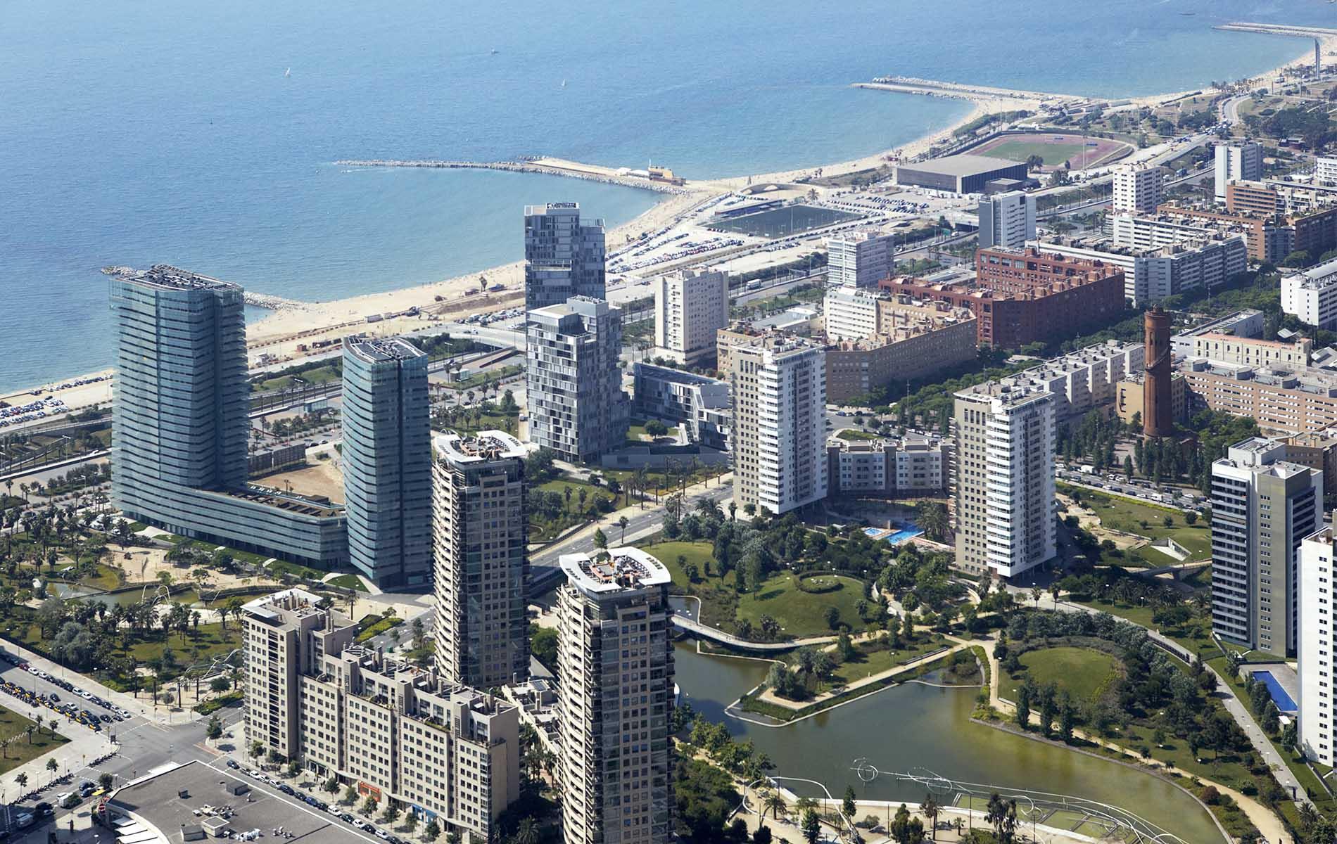 architecturephotography,barcelona,rafaelvargas photo,building,barcelona aerial view, glass facade,diagonal mar